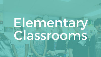 Elementary Classrooms. Image: students smiling, holding a rope web.