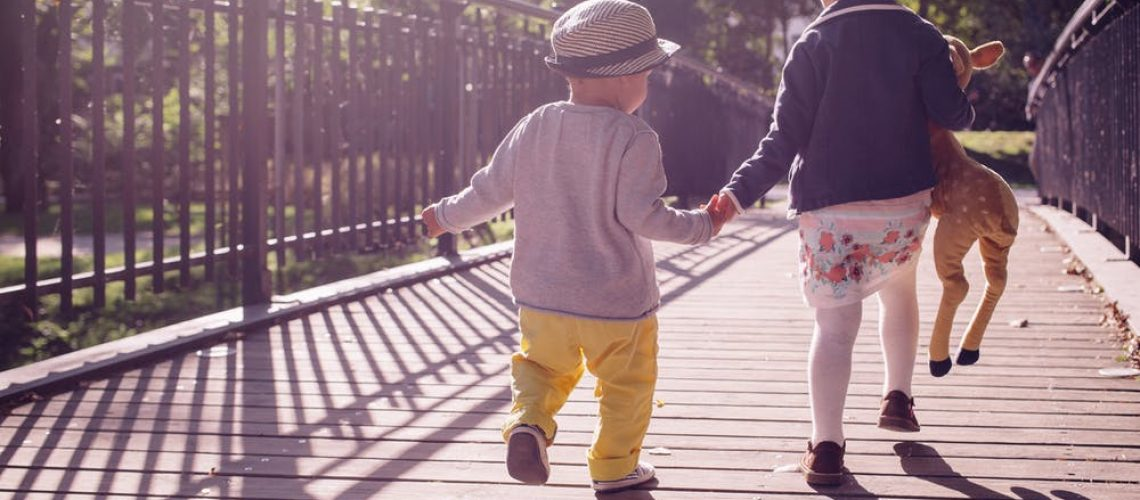 young children on a bridge