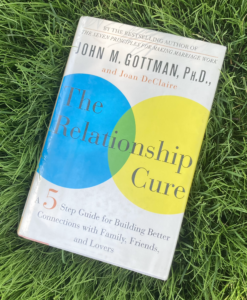 The Relationship Cure hardcover book on grass