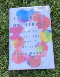 The Art of Gathering hardcover book on grass