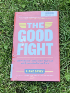 The Good Fight hardcover book on grass