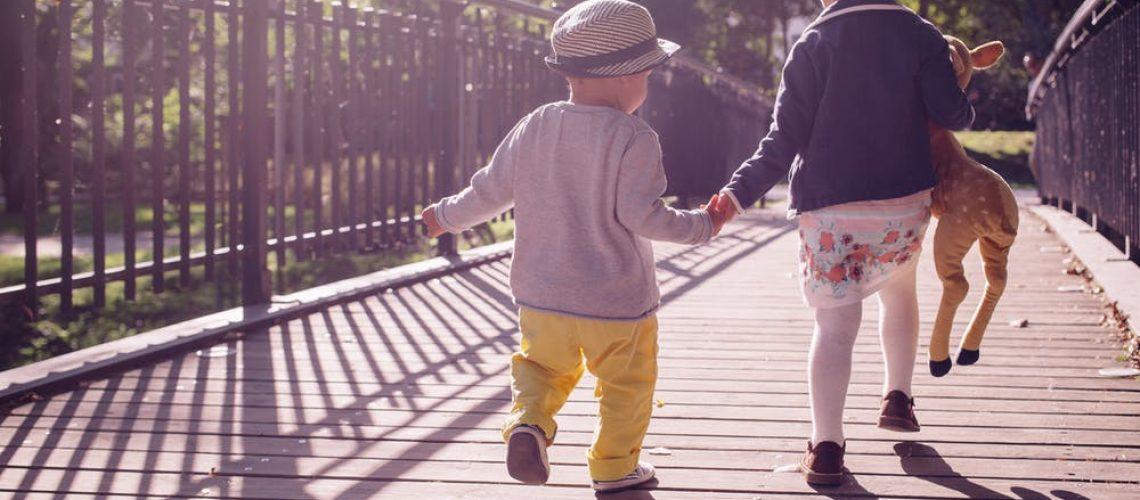 young children on a bridge